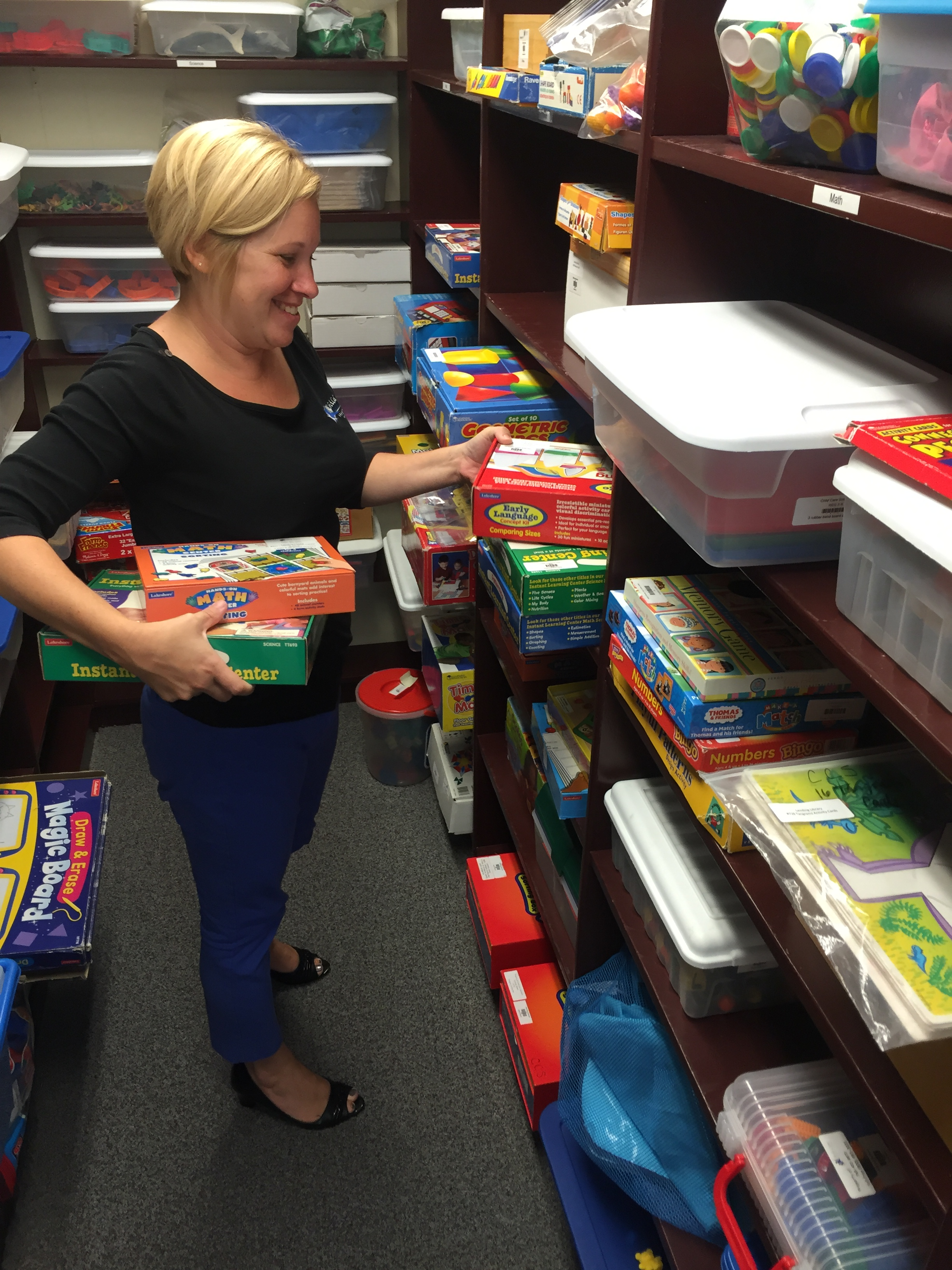 Michelle Kanable, director of Child Care Solutions, organizes the lending library.