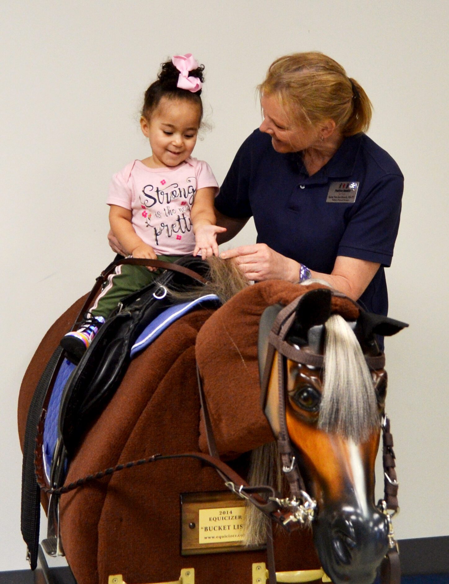 Child on therapies horse