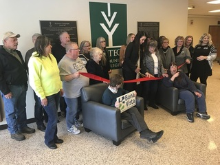 Ribbon cutting means open, officially